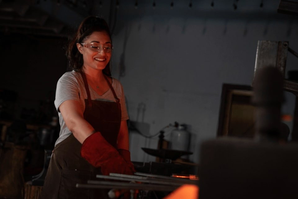 Pulling metal from the forge at Lawless Forge seattle