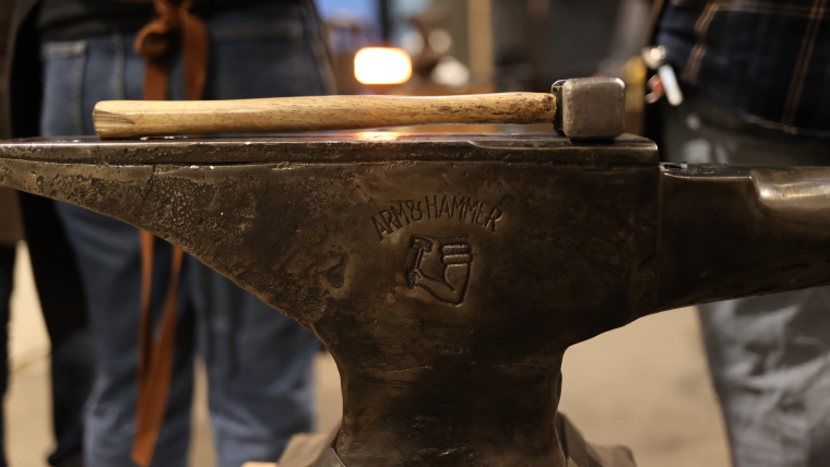 Hammer on in anvil in a blacksmith course